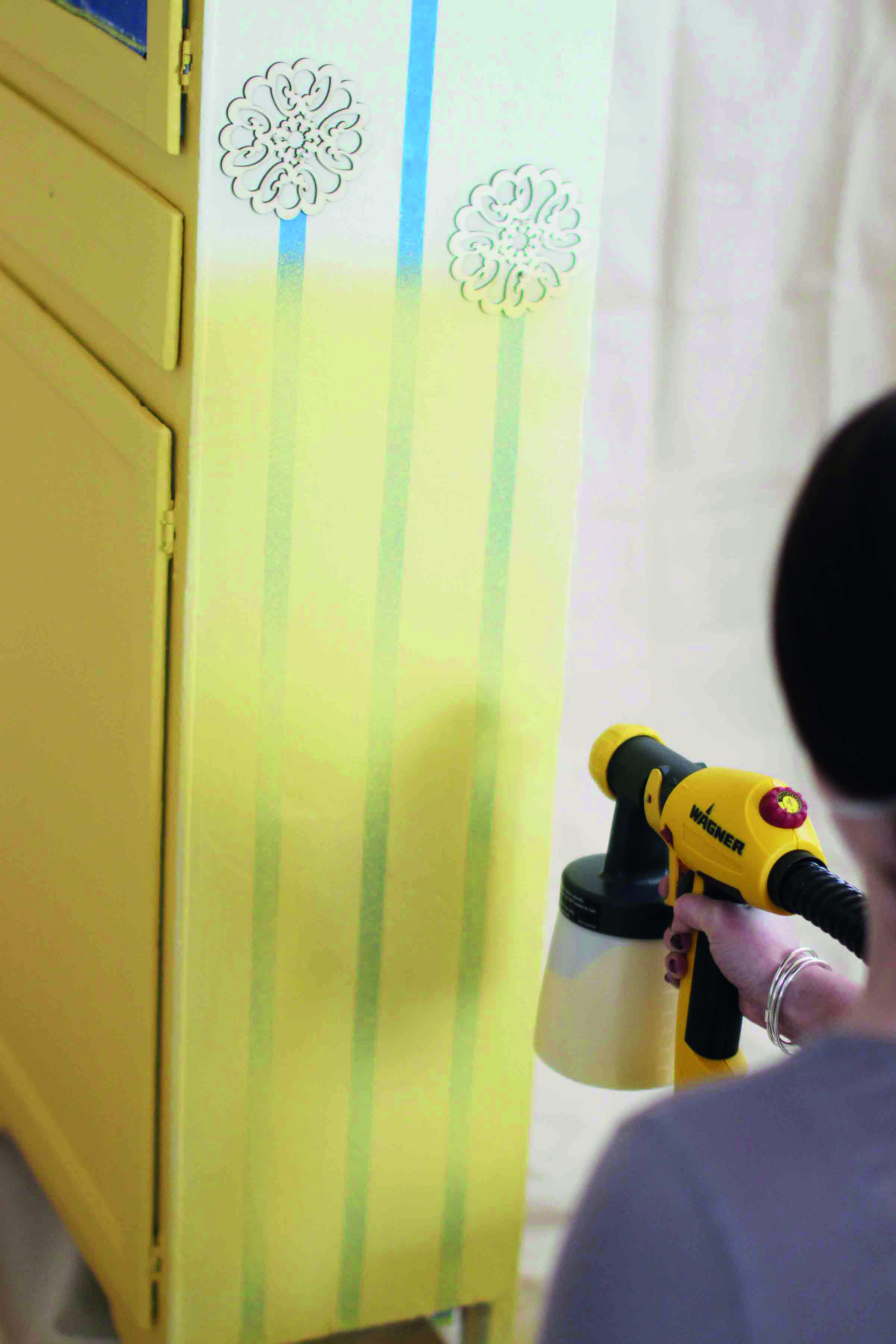Spraying the wardrobe with flower template